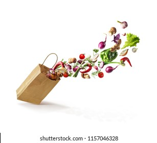 vegetables that fly out of a paper bag, isolated on a white background. Healthy Eating