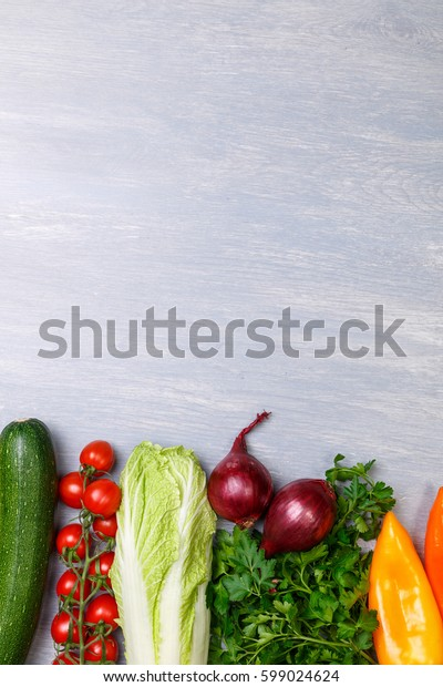 Vegetables. Tomatoes and pepper, onion. Parsley, zucchini and �hinese cabbage. Organic food with copy space.