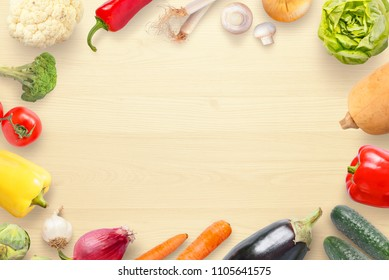 Vegetables view from above on kitchen table with copy space in the middle.