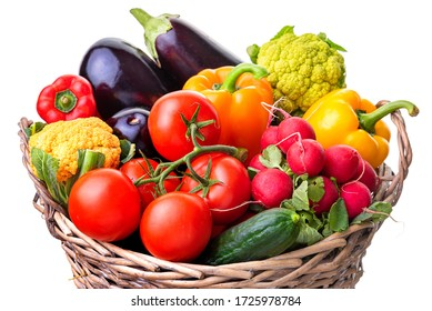 Vegetables in a wicker basket. Isolate on white background