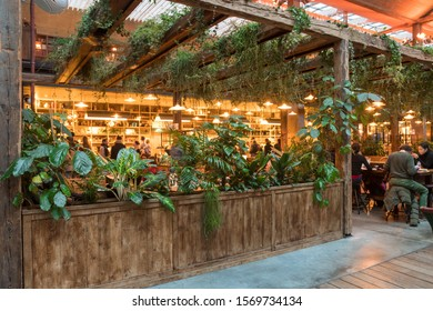 Vegetal dining hall in the Felicita italian food market (Big Mamma, Station f), Paris, France. November 2019. Biggest restaurant in Europe. Delicious food and beautiful setting.