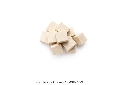 Vegetal nutrition. Cubes of fresh soybean Tofu cheese isolated on white background