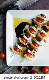Vegetarian antipasto kepbobs drizzled with olive oil and balsamic vinegar