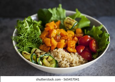 Vegetarian Buddha bowl with quinoa, butternut squash and courgettes