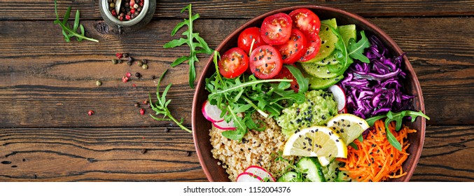 Vegetarian Buddha bowl with quinoa and fresh vegetables. Healthy food concept. Vegan salad. Top view. Flat lay. Banner