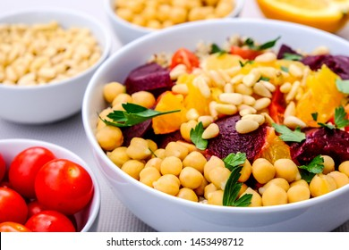 Vegetarian Bulgur Wheat and Quinoa Lunch Bowl With Orange Segments, chickpeas, Beetroot and Tomatoes