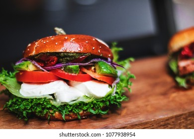Vegetarian burger with vegetables, mozzarella, greens and sauce