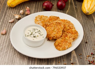 Vegetarian carrot and corn meatballs on wooden background