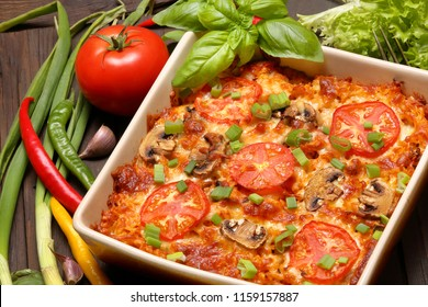 Vegetarian casserole with mushrooms and tomato in brown bowl