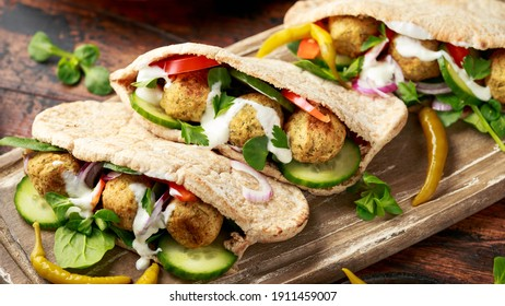 Vegetarian Chickpea falafel pita bread with pickled chilies and fresh salad. healthy vegan food