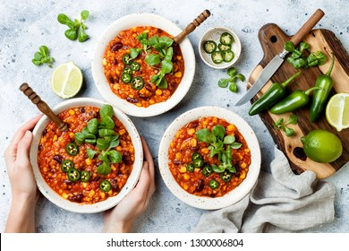 Vegetarian chili con carne with lentils, beans, lime, jalapeno. Mexican traditional dish