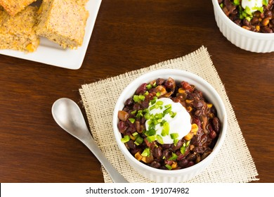 Vegetarian chili made with onions, tomatoes, corn, kidney and black beans, topped with sour cream and diced jalapeno, served with cornbread