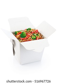 Vegetarian Chinese food. Noodles with vegetables isolated on white background. Opened take out box.