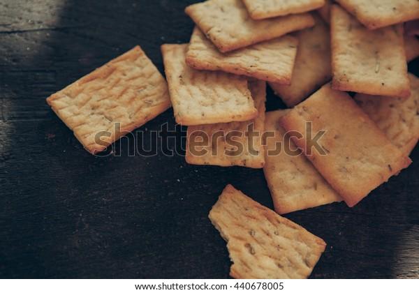vegetarian crackers on dark wood