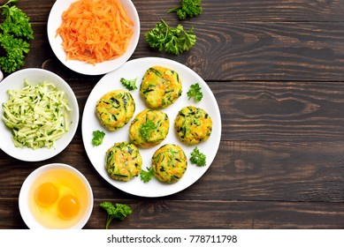 Vegetarian cutlet from carrot, zucchini, potato on wooden background with copy space. Concept of healthy diet food. Top view, flat lay