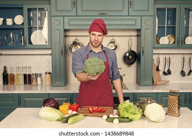 Vegetarian diet concept. Culinary recipe. Chef cooking vegetarian recipe. Vegetarian cuisine rich vitamins. Man chef wear apron cooking in kitchen. Man cook vegetarian recipe with fresh vegetables.