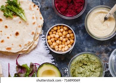 Vegetarian dip table with flatbread naan and chickpeas hummus meze food