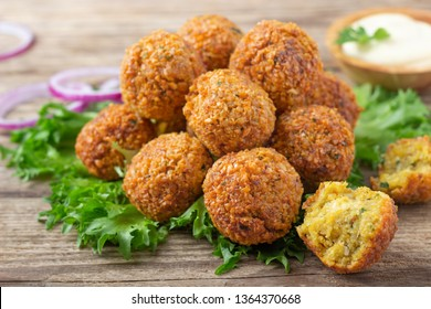 Vegetarian dish - falafel balls from spiced chickpeas on wooden rustic table.