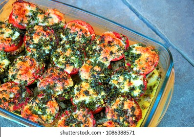 Vegetarian dish. Vegetables baked in the oven with cheese: eggplant, zucchini, tomato, onion and garlic. Spicy herbs, green onions and dill. Healthy and diet food, minimal protein and carbohydrates.