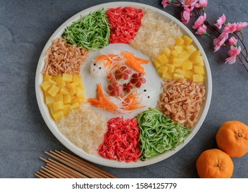 Vegetarian festive cuisine / Gold Fish Shape Prosperity Toss / Made entirely of vegetables and fruits. In chinese's belief fish or yu means abundance and prosperous