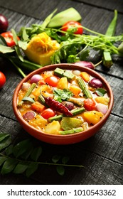 Vegetarian food concept - tasty south Indian sambar dish on a wooden background.,