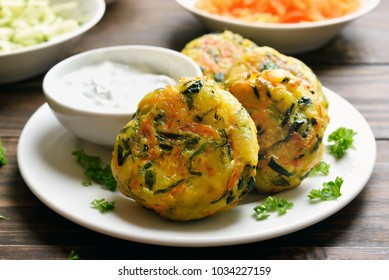 Vegetarian food. Vegetable cutlet from carrot, zucchini, potato with sauce. Healthy diet food. Close up view