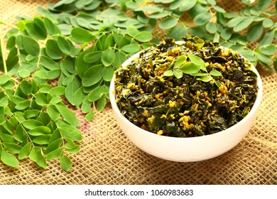 Vegetarian foods curry- delicious moringa leaf fry with coconut and spices.