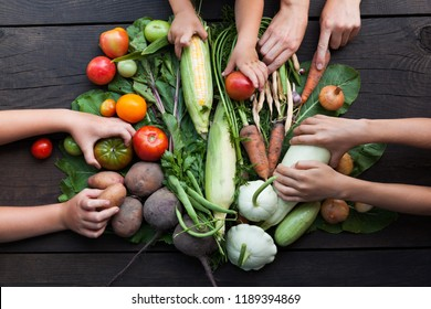 Vegetarian fresh organic food. Vegetables on a wooden background.