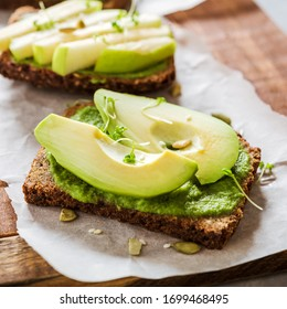 Vegetarian green sandviches with an avocado and apple,healthy breakfast