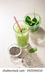 Vegetarian  green smoothie from avocado, spinach leaves and chia seeds on stone table. Selective focus