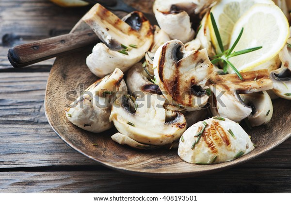 Vegetarian grilled mushroom with lemon and rosemary, selective focus
