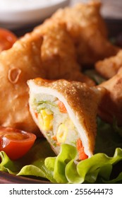 Vegetarian Indian samosa pastry with potatoes and beans macro. vertical