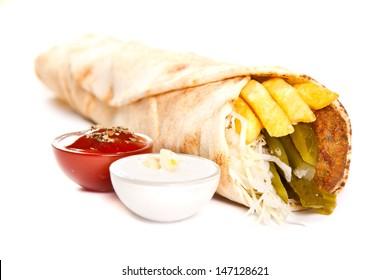 Vegetarian kebab with fries and vegetables