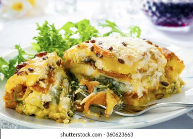Vegetarian lasagna or lasagne.  Made with sweet potato, pumpkin, spinach and pine nuts.