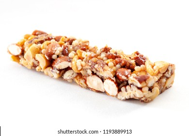 Vegetarian lifestyle and balanced nutrition concept with an energy bar with nuts which contain protein and healthy fat and honey which is high in natural carbs isolated on white with clip path cutout
