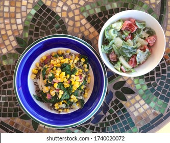 vegetarian meal with corn, chard, onion and quinoa with mixed salad