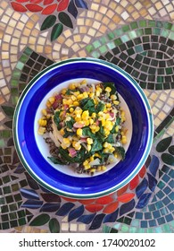 vegetarian meal with corn, chard, onion and quinoa