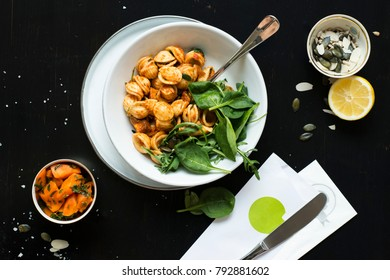 Vegetarian meal on wooden table. Top view