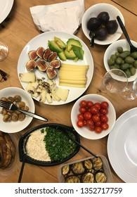 Vegetarian and Mediterranean food displayed on table.