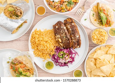 Vegetarian Mexican food. Veggie enchiladas, tacos, burritos, and rice bowls served in a Mexican restaurant. Spicy, fresh, and organic food.