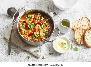 Vegetarian minestrone - delicious healthy mediterranean lunch. On a light table, flat lay
