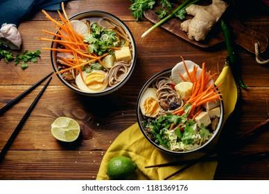 Vegetarian miso ramen with shiitake mushrooms, fried tofu, carrot, cabbage, leek and lime. Asian cuisine