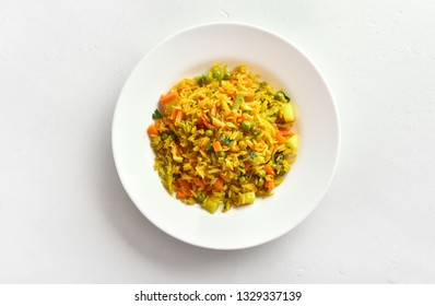Vegetarian pilaf on plate over white stone background with copy space. Healthy diet food. Top view, flat lay