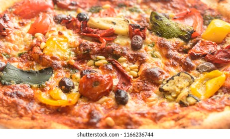 Vegetarian Pizza D Shadow Depth of Field Close up Food Photography; Pizza with Pepper, Courgette, Olives and Pesto