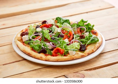 vegetarian pizza with fresh tomatoes, olives, tofu and red onion