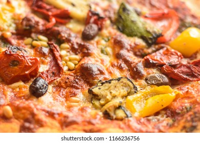 Vegetarian Pizza H Shadow Depth of Field Close up Food Photography; Pizza with Pepper, Courgette, Olives and Pesto
