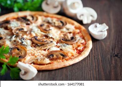 Vegetarian pizza with mushrooms, selective focus