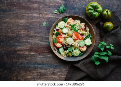 Vegetarian quinoa salad with mint, tomato, cucumber. Tabbouleh salad. Traditional middle eastern or arab dish