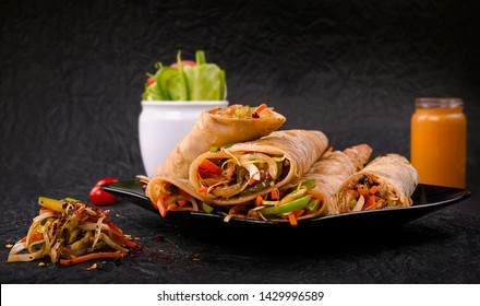 Vegetarian roll with vegetables and tofu on wooden table close up