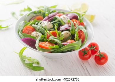 Vegetarian salad with cherry tomato, mozzarella and rucola